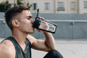 man drinking from mous fitness bottle black