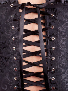 Waist training corsets tied and fitted