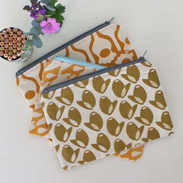 Screen-printed pouches featuring India Johnson's designs, Greengage Studios