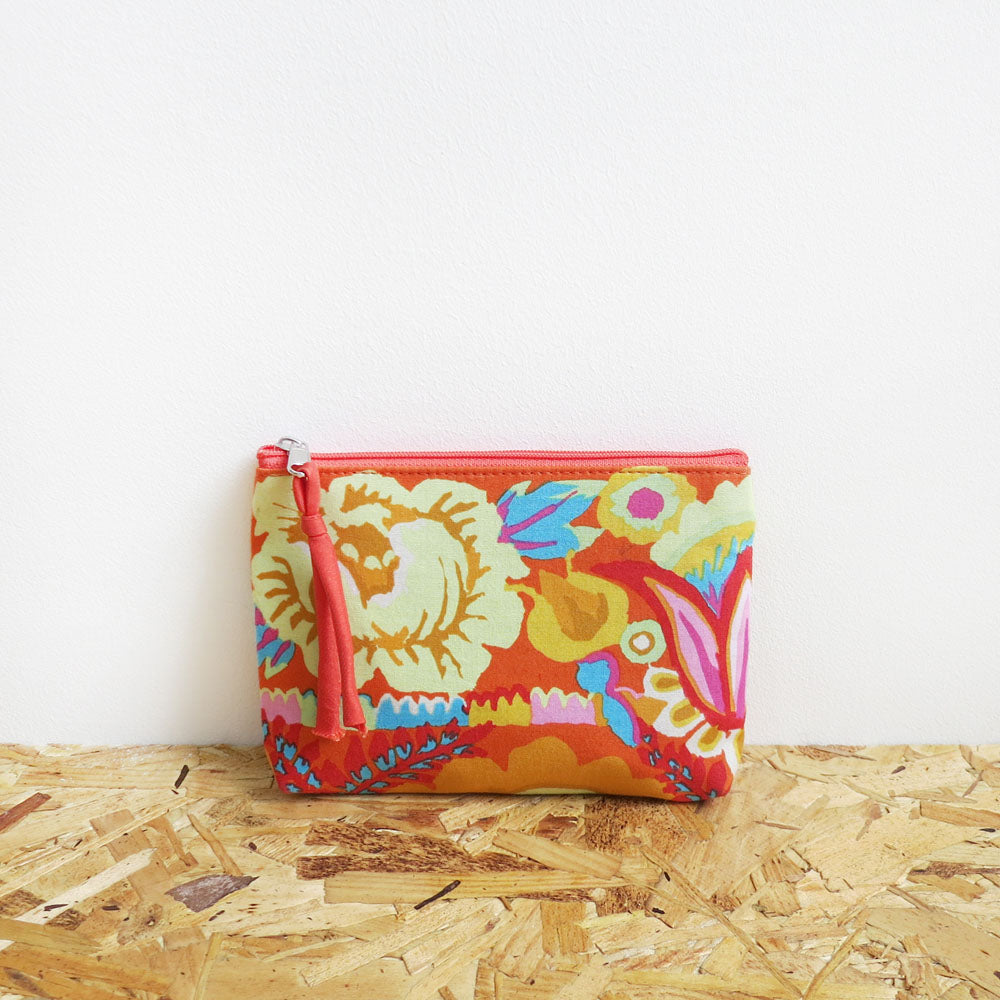 Vegan purse featuring Kaffe Fassett's Flower Border design in coral