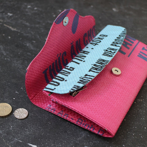 Detail of the upcycled pink fish clutch purse