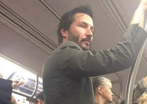 Keanu Reeves riding the train