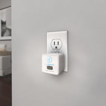 Load image into Gallery viewer, LeakSmart Zigbee Range Extender product image plugged in to a home wall power outlet.