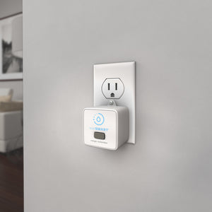 LeakSmart Zigbee Range Extender product image plugged in to a home wall power outlet.
