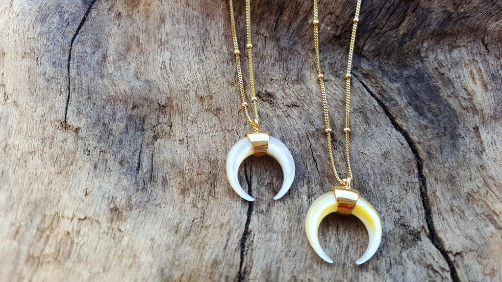These delicate crescent Mother of Pearl pendants are the perfect surfer chic addition to any collection.