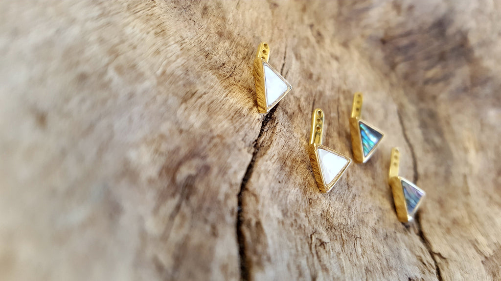 Triangle shell earring jackets in 14kt yellow gold.