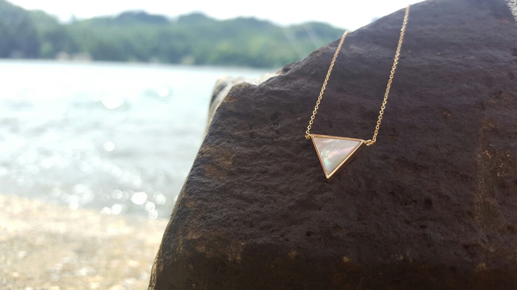 triangle shell and gold necklace by Heather j studios a local Seattle based jewelry designer and artist.