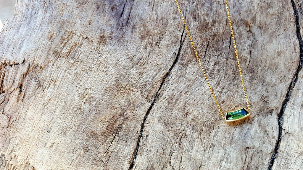 Delicate tourmaline and yellow gold necklace by jewelry designer Heather Johnson.