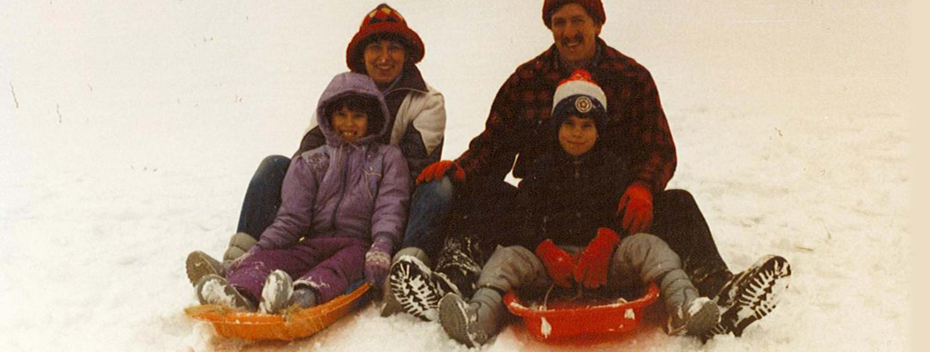 Young Ryan Smoker with his family on sleds