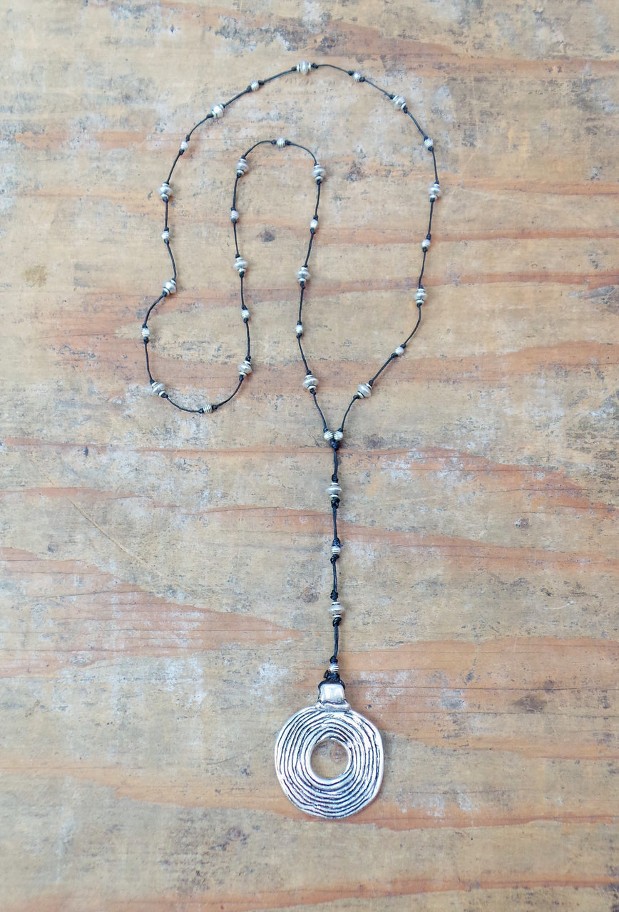 Bali Queen Wholesale silver Rhodium based alloy metal Etched Disc Necklace on waxed lined cord. Made in Bali, Hypoallergenic, Tarnish resistant. Rhodium based alloy metal on waxed linen cord. Vegan.
