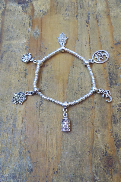 Bali Queen Wholesale silver rhodium based alloy metal Om and Hamsa stretch charm bracelet.  Made in Bali, Hypoallergenic, Tarnish resistant. Vegan.