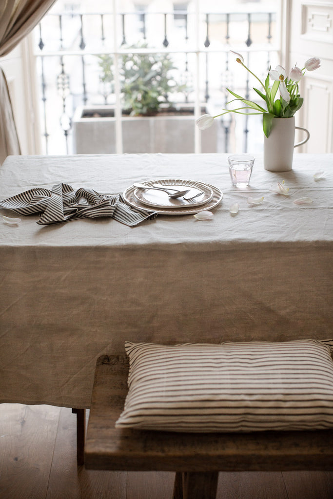 simple natural table setting with linen and stripe napkin