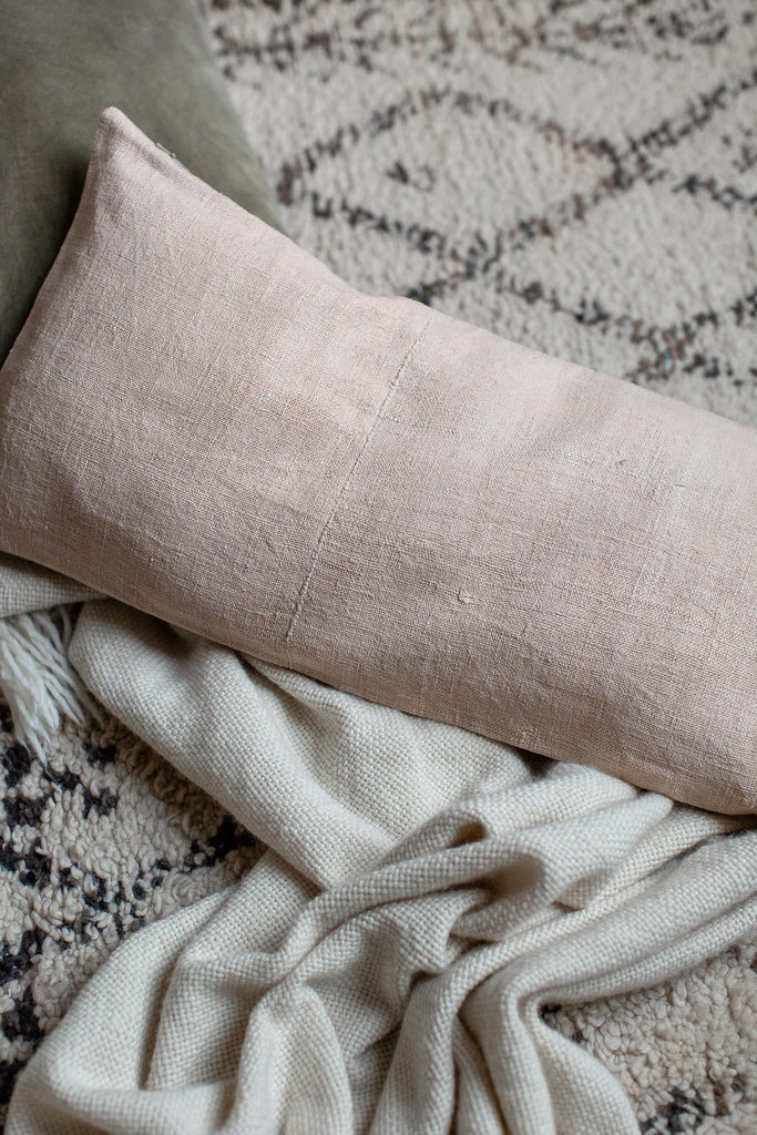 vintage hand dyed linen cushion cover in soft pastel pale pink