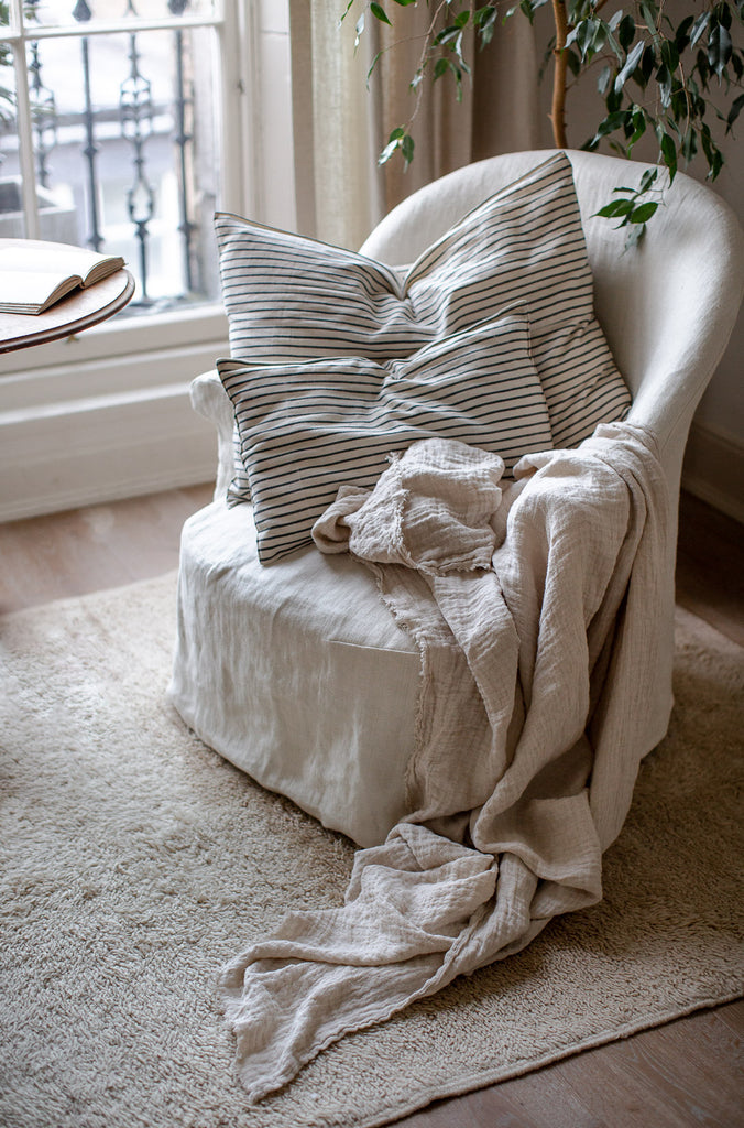 handmade crushed linen blanket in warm cream colour