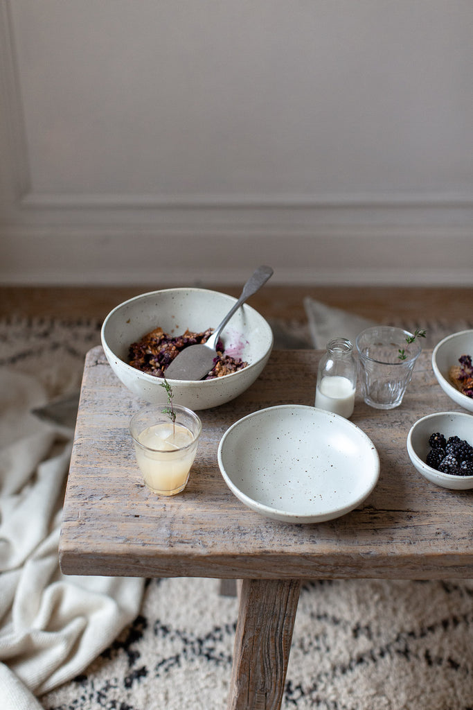 natural breakfast table with handmade ceramics and wood