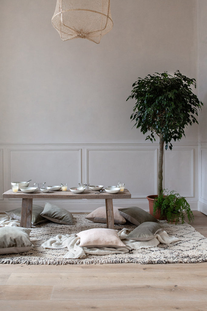 natural home decor with linen, wool, wood and plants
