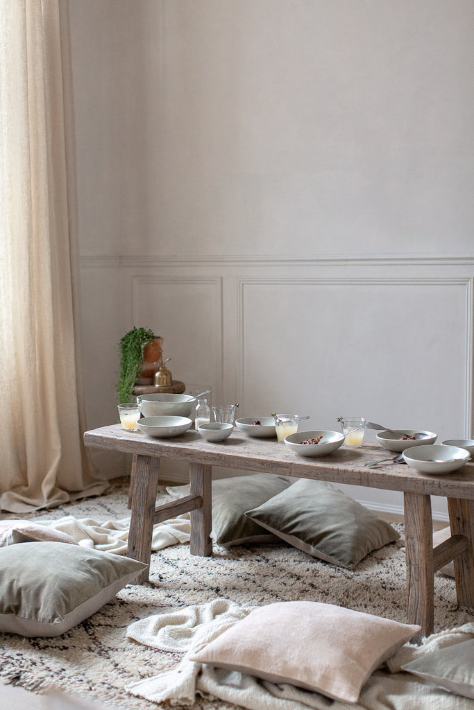 natural sunny breakfast table with linen, wood and wool