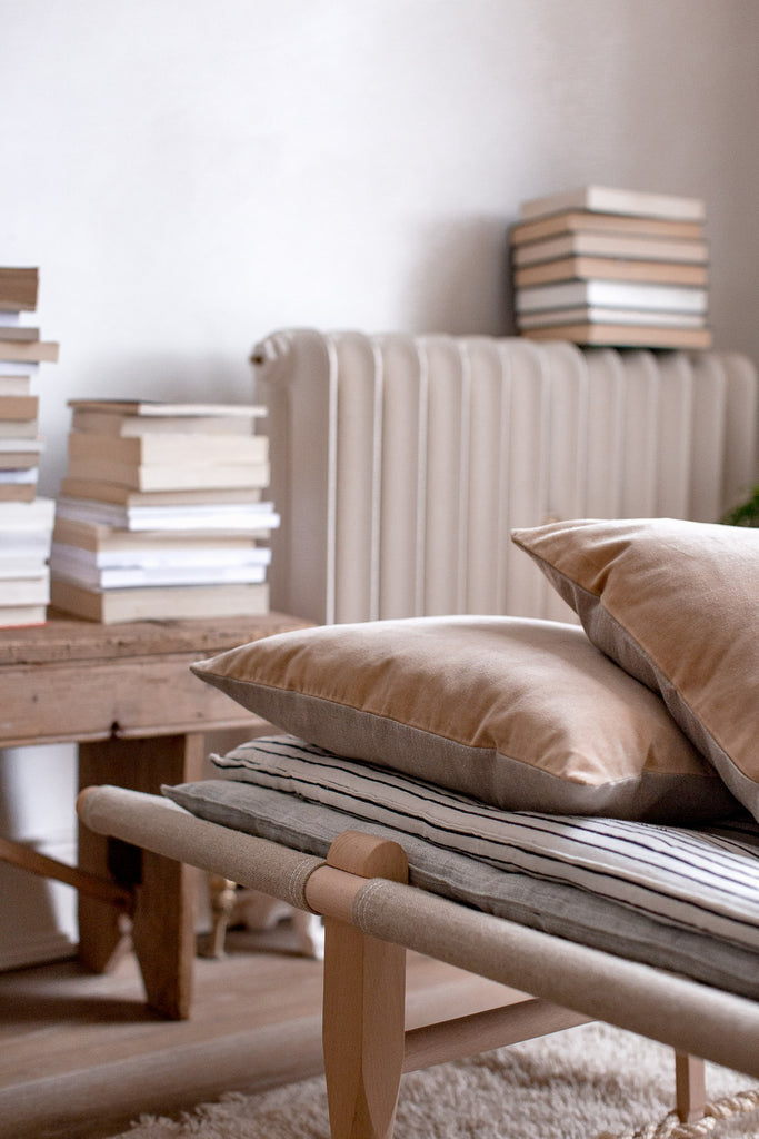 daybed and stack of books