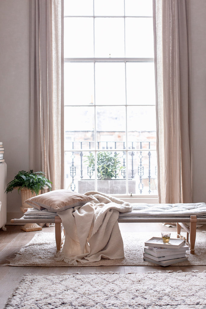 soft cosy daybed by a large window