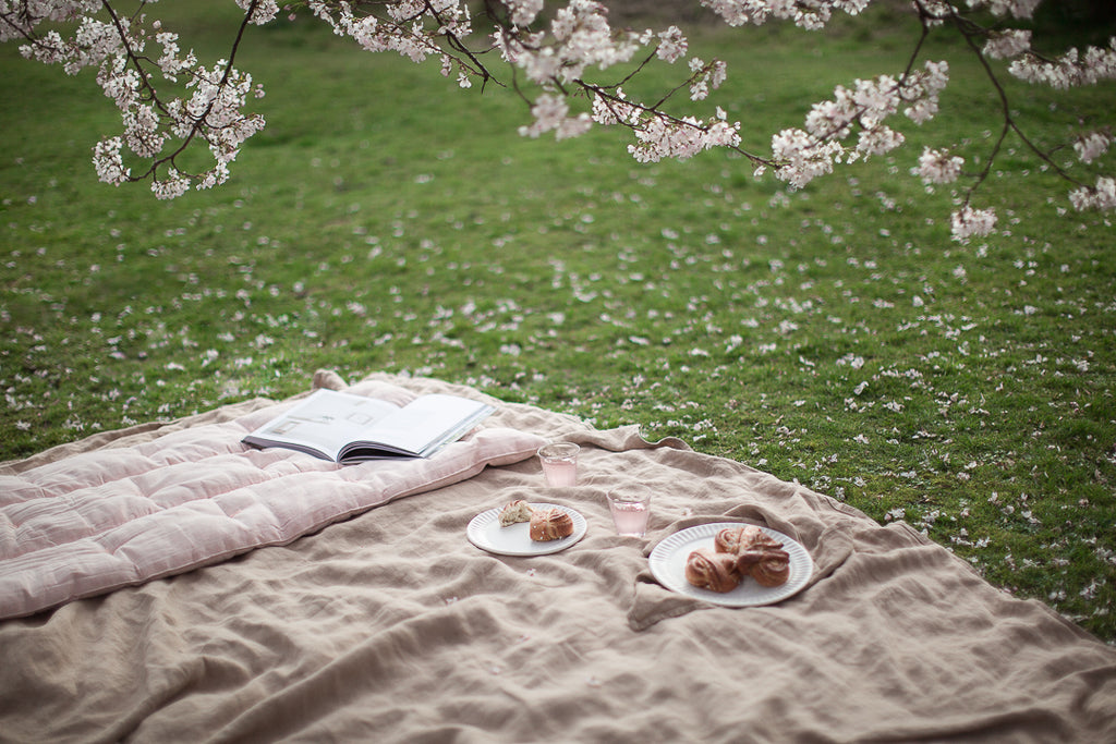 cherry blossom picnic with linen blanket