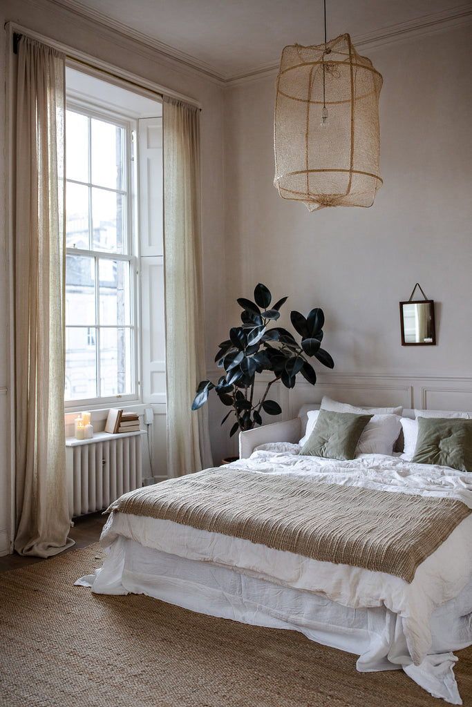 Calm, natural bedroom decor with linen
