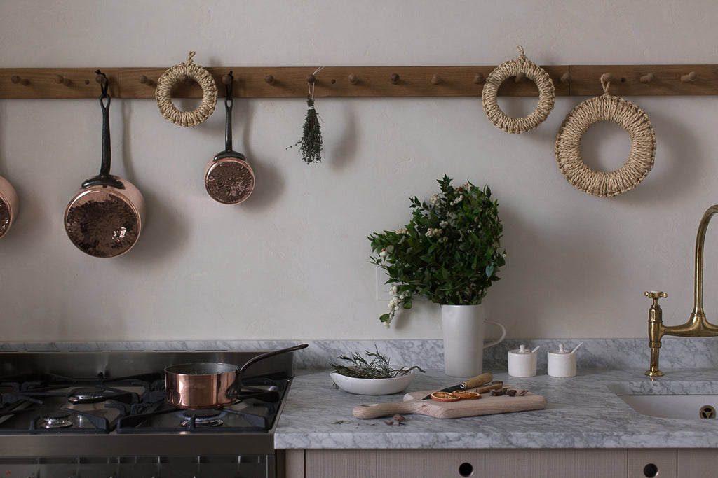 kitchen rail with copper pots