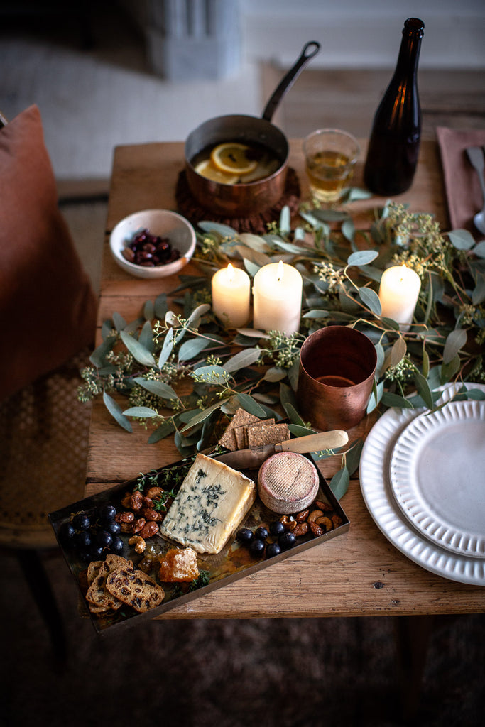 winter tablescape with mulled cider and cheese