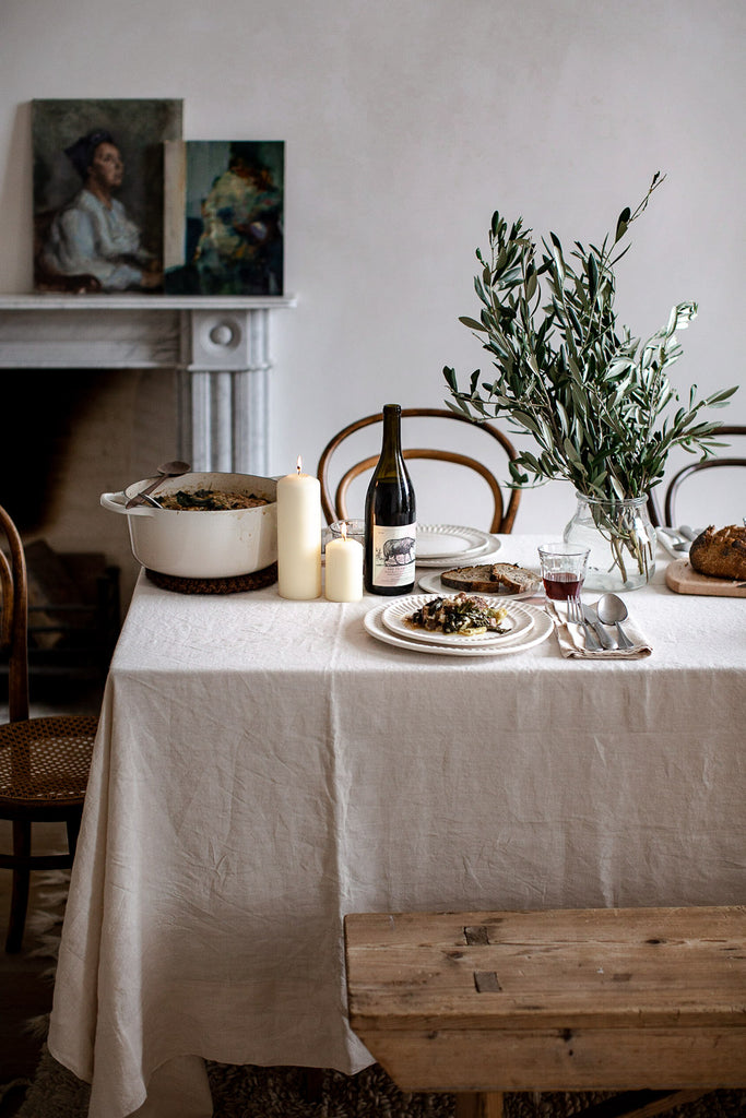 natural table decor with linen and olive branches