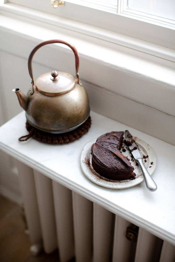 aged copper kettle with patina and handmade cake plate