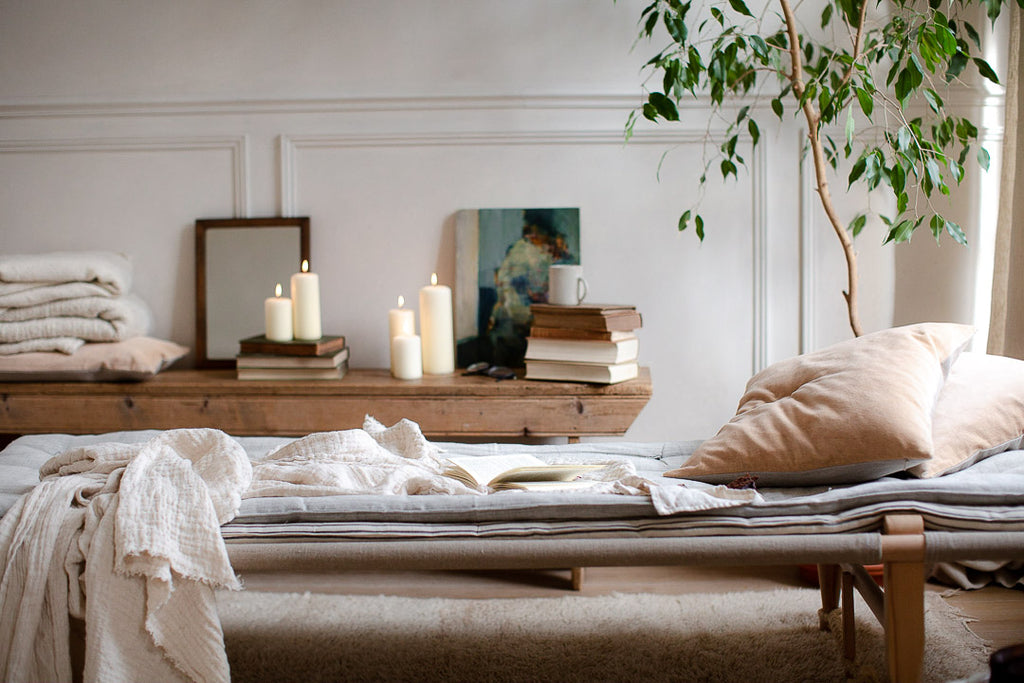 wooden daybed with soft stacked mattresses