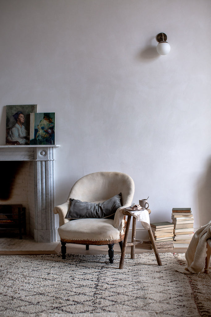vintage french chair and marble fireplace