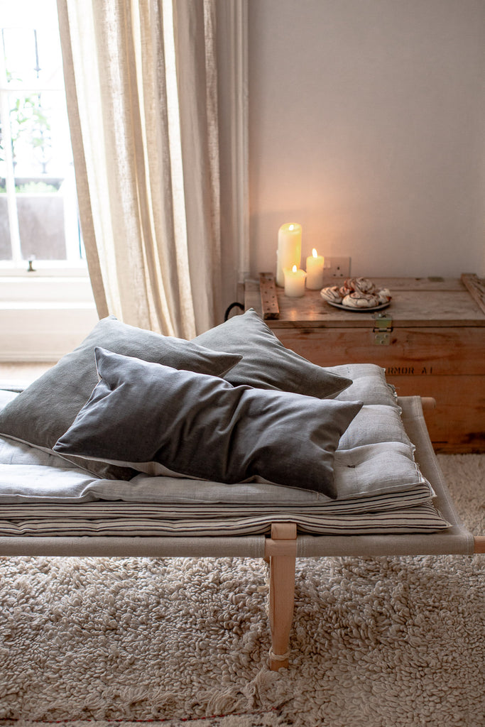 daybed with mattress stack and velvet cushions