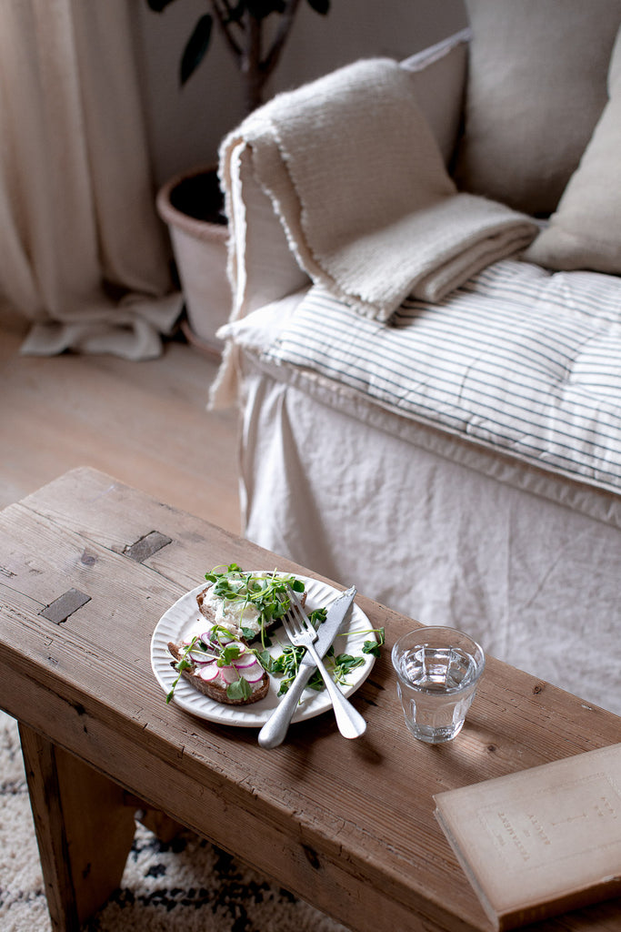 natural home with linen, handmade ceramics, wood and vintage furniture