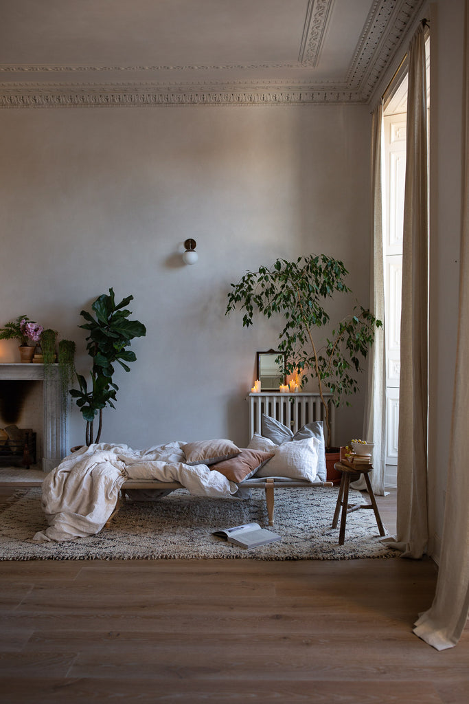 natural home decor with linen and indoor plants