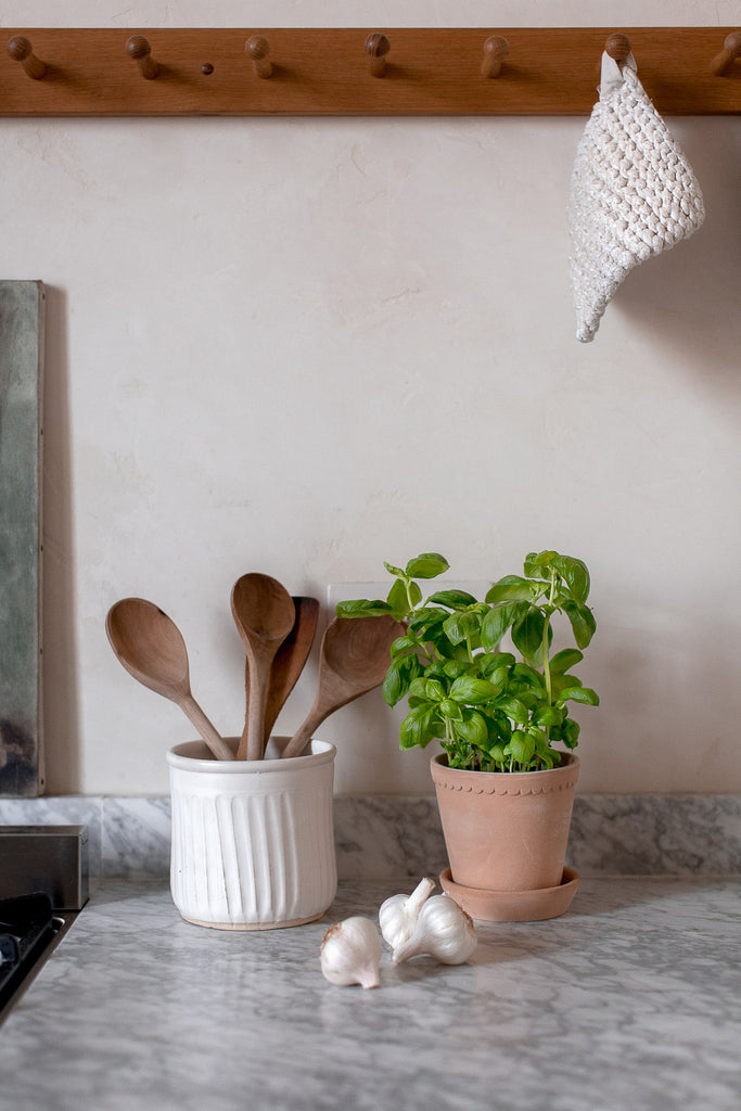 handmade wooden spoon and kitchen utensil holder