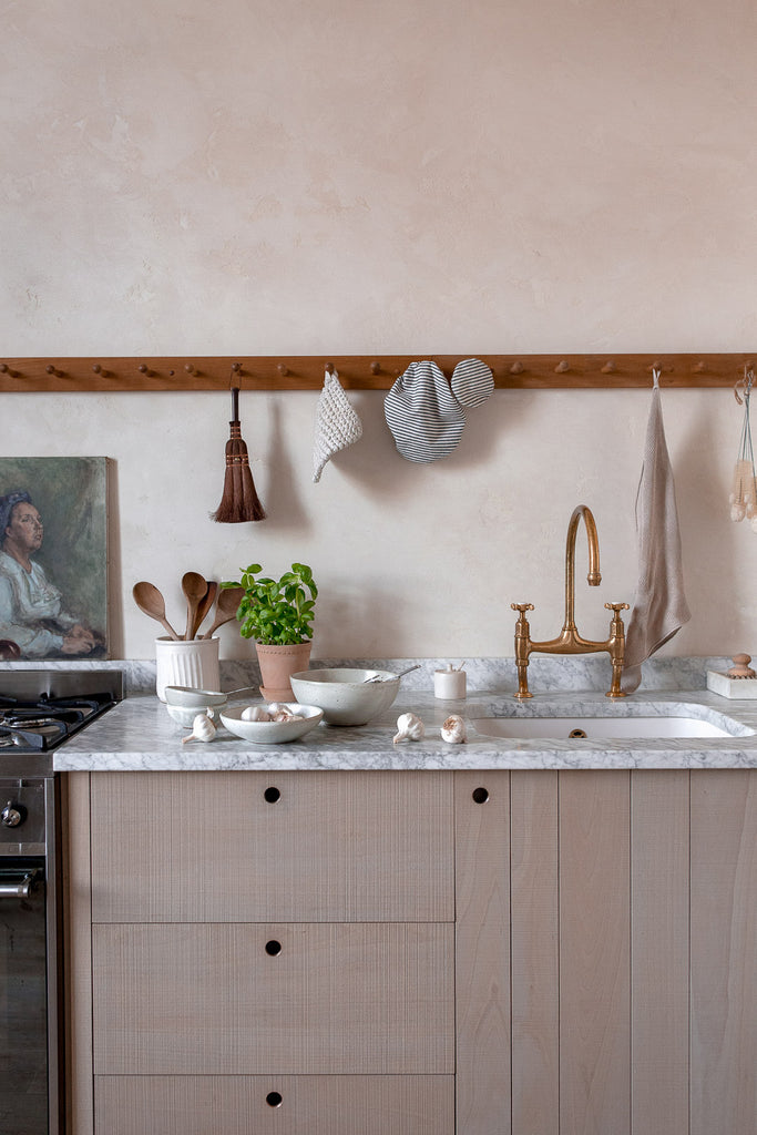 simple, natural kitchen with wood and marble