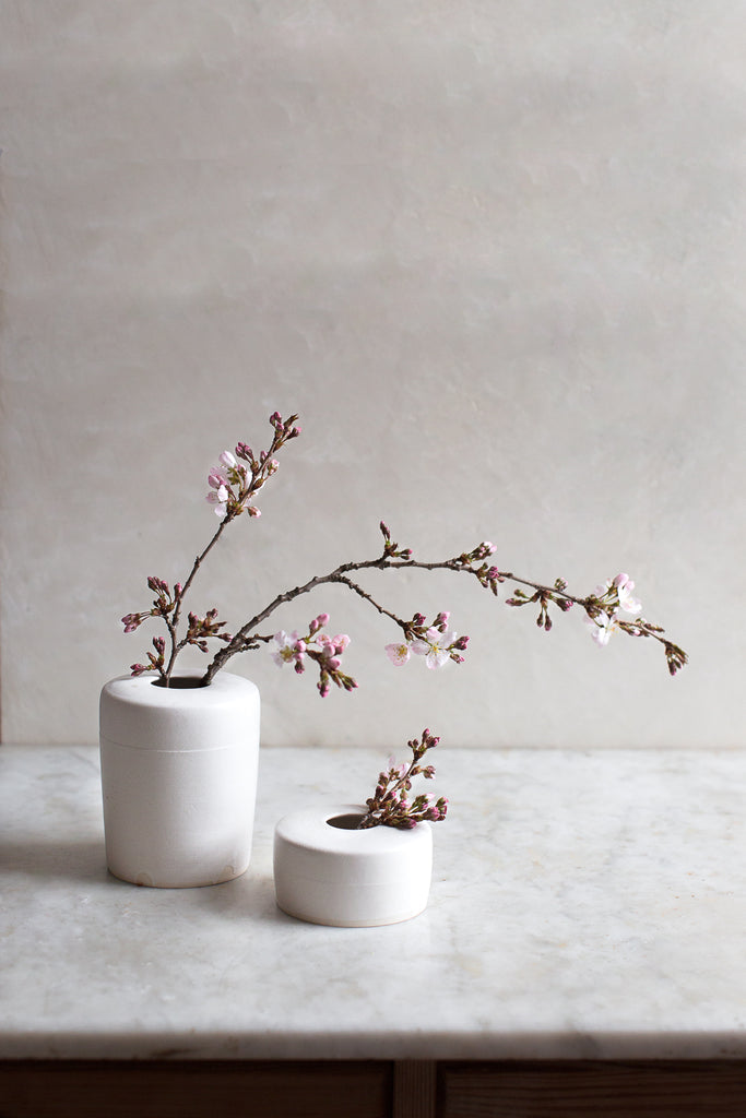 pair of modern handmade vases in matte white glaze