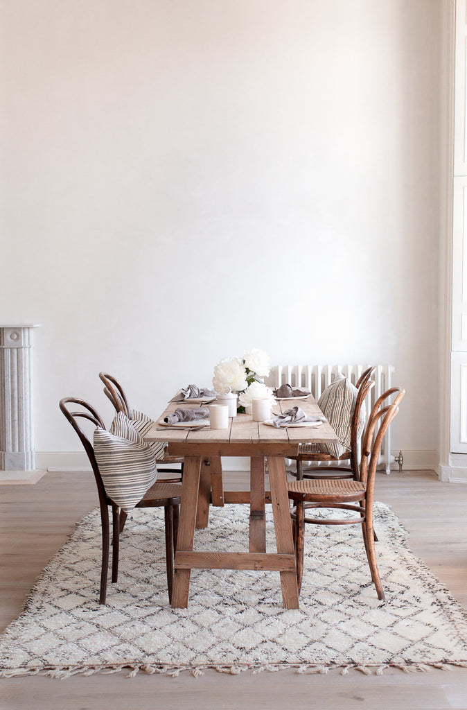 Thonet bentwood chairs and beni ourain rug