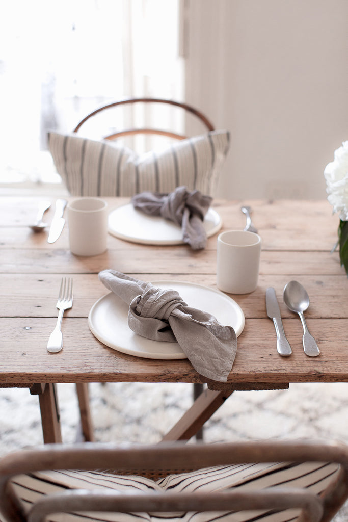 Simple tablescape with wood, linen and flowers