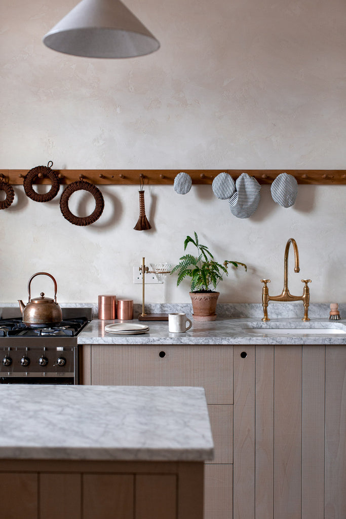 natural wood and marble kitchen with beautiful kitchen details