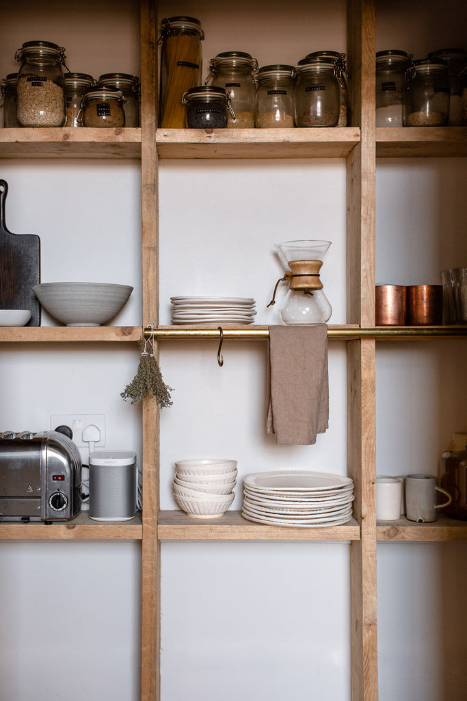 wooden kitchen pantry shelving with rustic decor