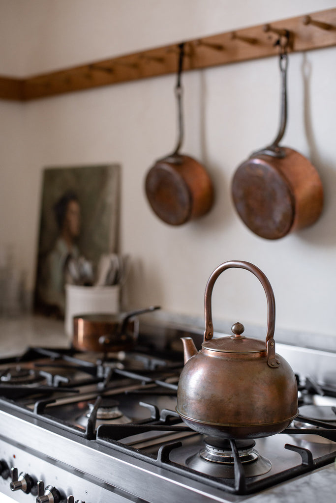 aged copper kettle