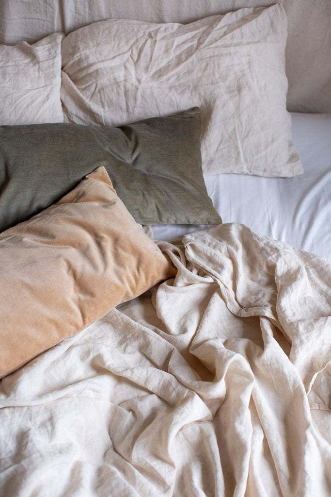 natural pastel coloured velvet cushions for the bedroom
