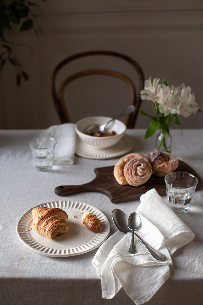 breakfast table with linen and wood
