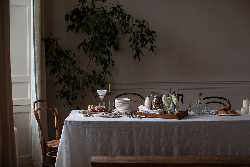 natural breakfast table  setting with linen and handmade ceramics