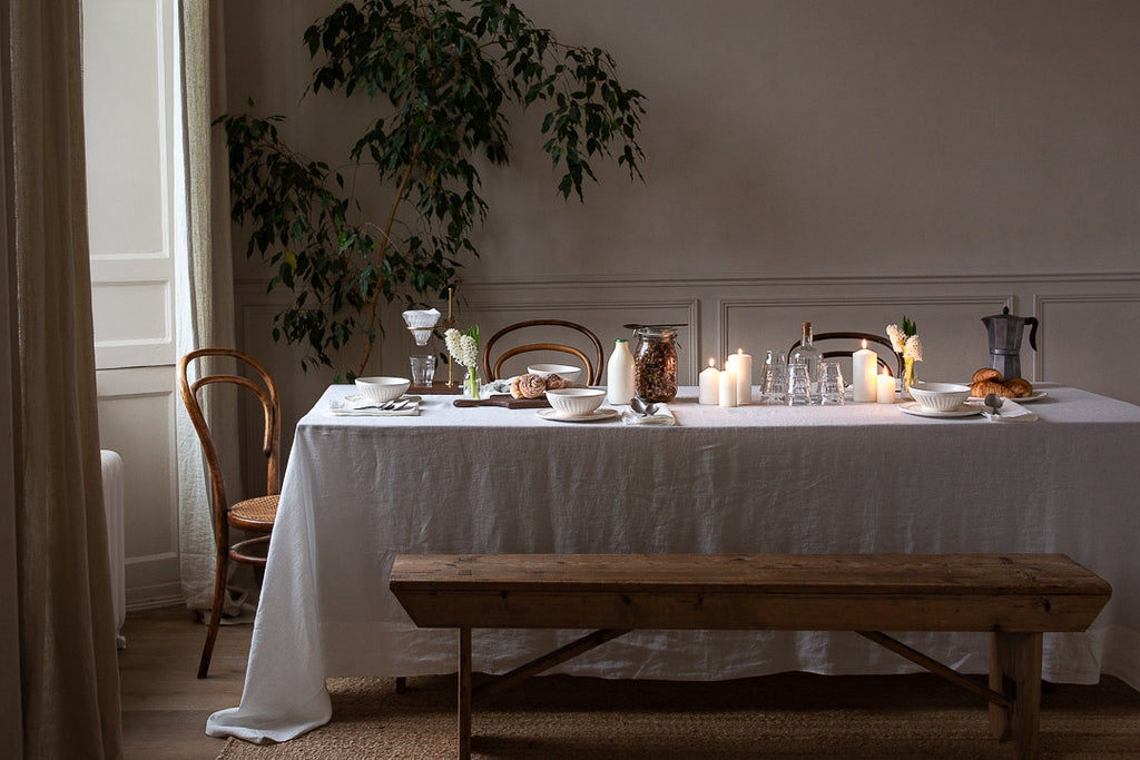 natural breakfast table setting with linen, plants and wood