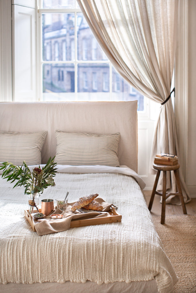 breakfast in bed in a calling bright natural bedroom
