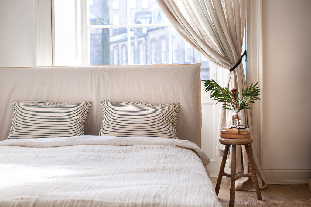 bright natural bedroom with linen and wool