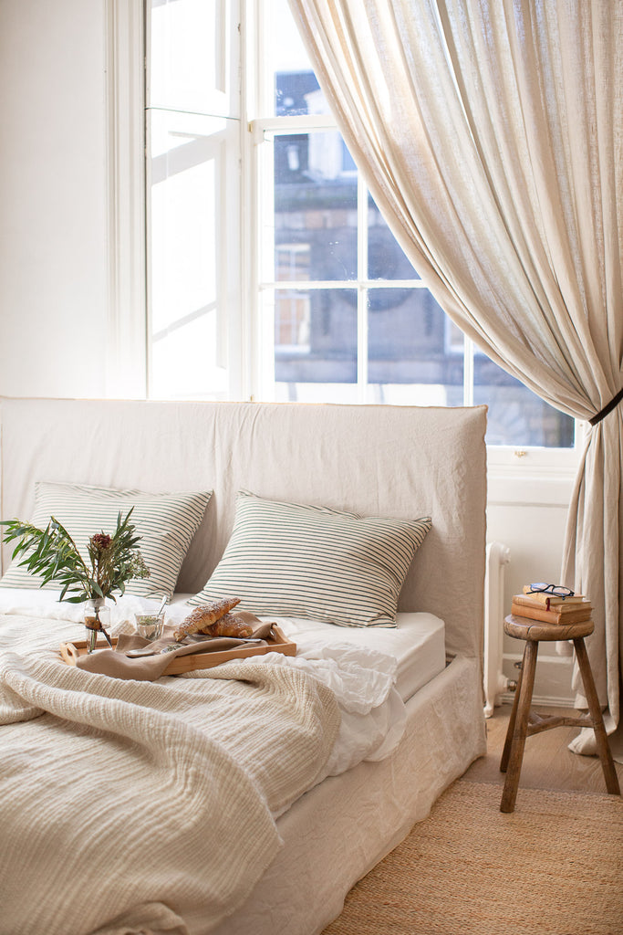 natural organic bedroom decor with linen, wool and jute