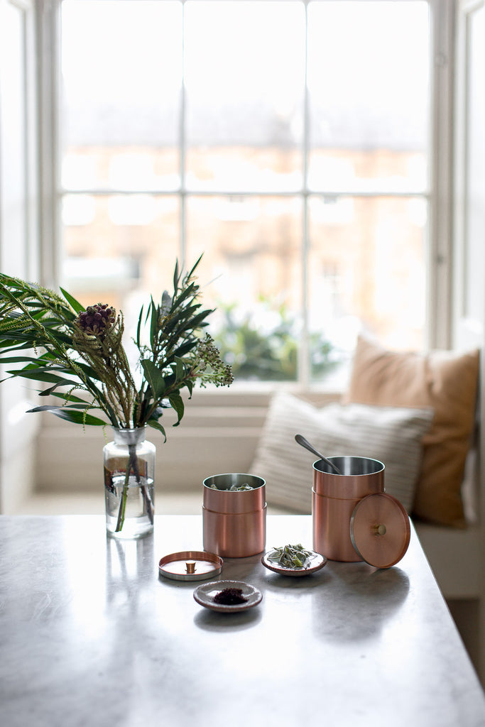 copper coffee and tea containers